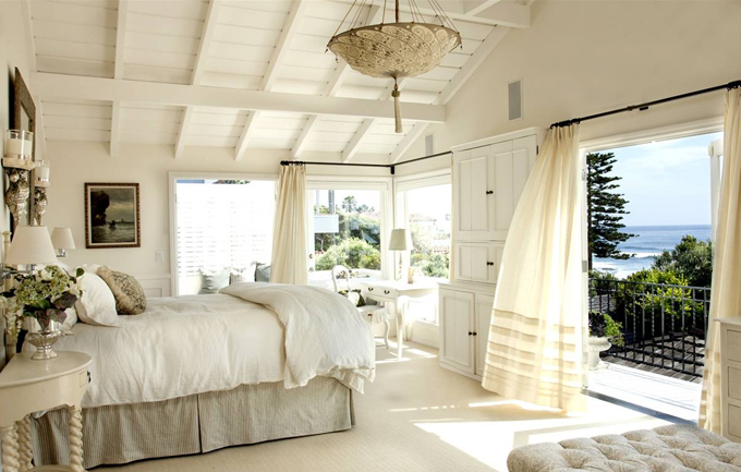... Use light curtains to give the room a breezy, beach-style look ...