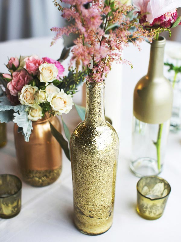 Empty glass bottles fill in as gorgeous wedding centerpieces for Empty bottle decoration ideas