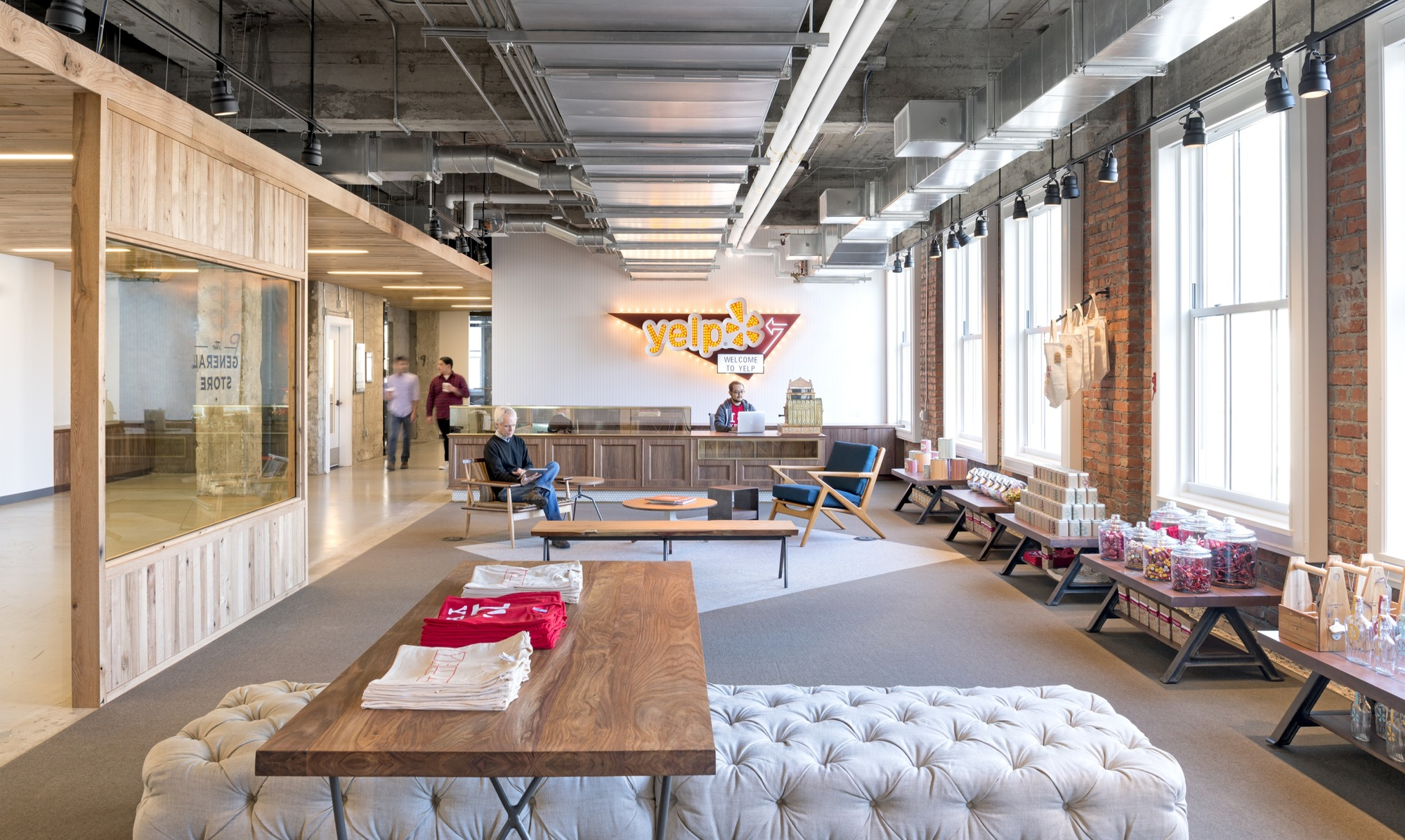 Exposed brick walls concrete define the new yelp headquarters