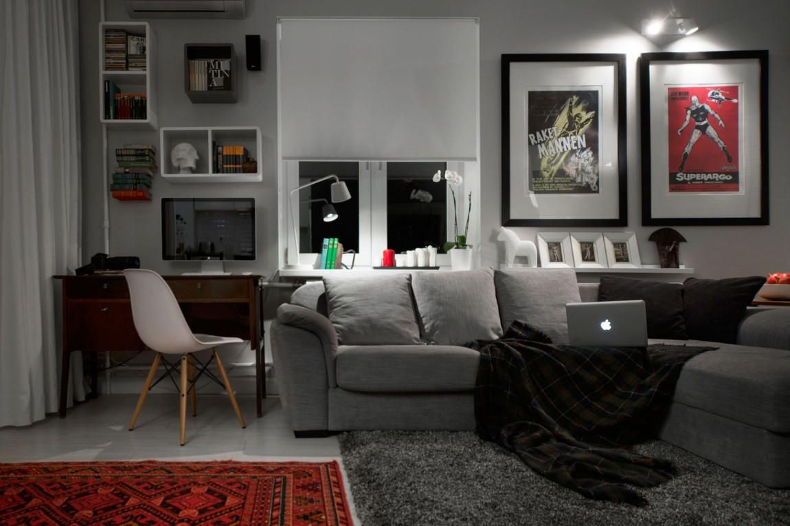Compact bachelor pad captures all the right details in an for Mens living room decorating ideas