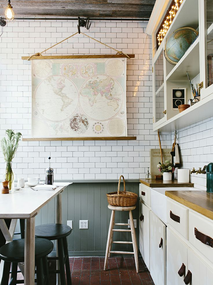 ... A quirky accessory like this map completely transforms the room ... : kitchen-with-subway-tile - designwebi.com