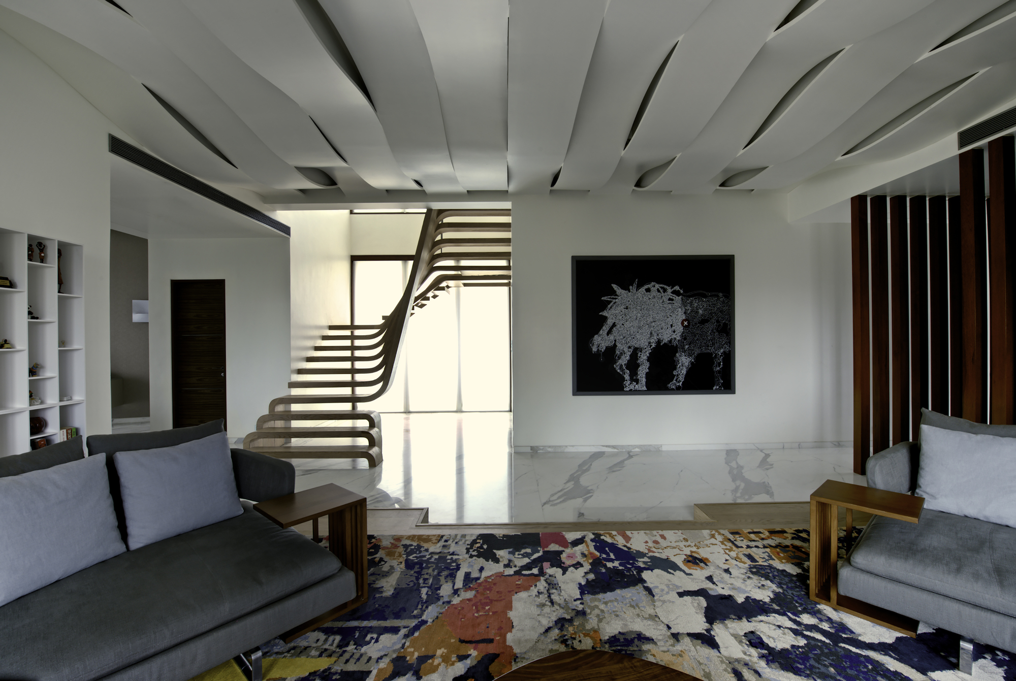 Sculptural staircase defines a modern two storey apartment for Multi storey apartment modern design