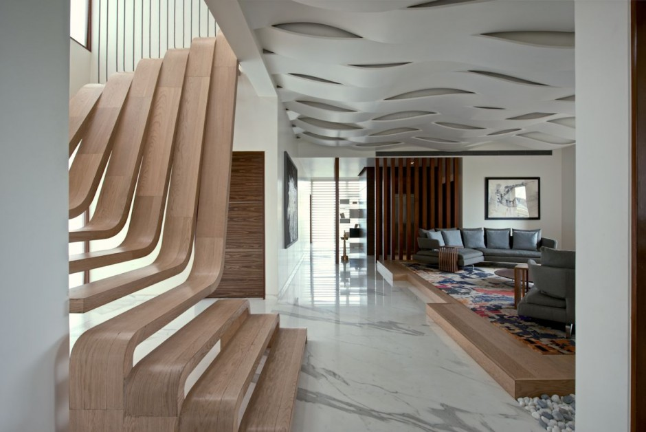 Sculptural staircase defines a modern two storey apartment for Balustrade acier exterieur