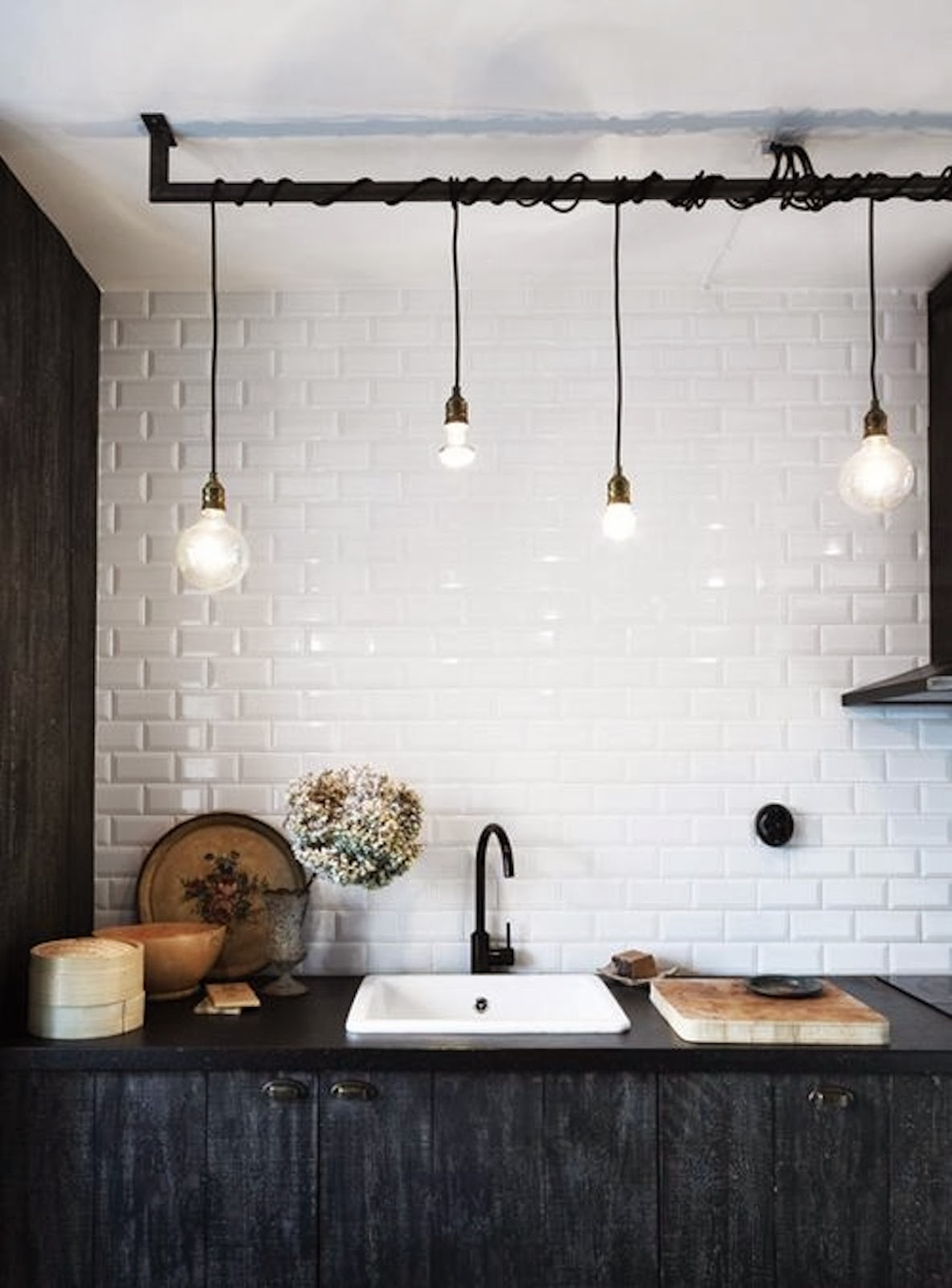Kitchen subway tiles are back in style 50 inspiring designs the finish on the cabinets and the lighting fixture are two key elements in this dcor dailygadgetfo Image collections