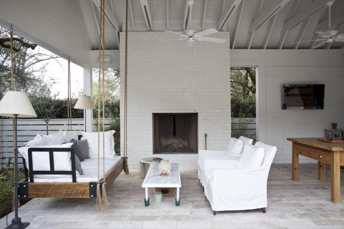A Hanging Daybed On The Porch Is Nice Alternative To Regular Seating