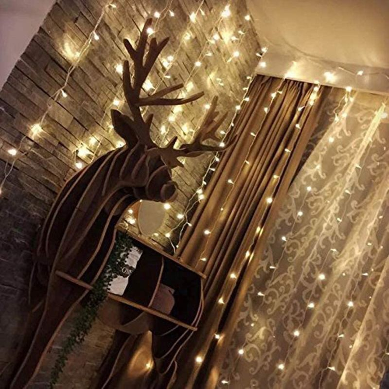 Twinkle Star 300 LED Window Curtain String Light - How You Can Use String Lights To Make Your Bedroom Look Dreamy