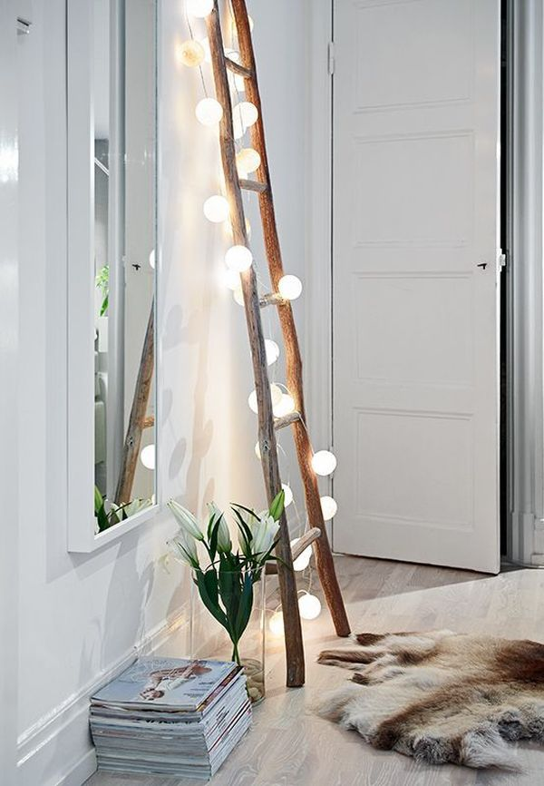 bedroom lights on a ladder - How You Can Use String Lights To Make Your Bedroom Look Dreamy