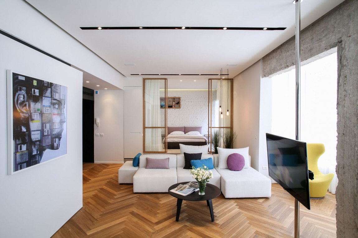 Herringbone Floors And Concrete Columns Linked By Modern