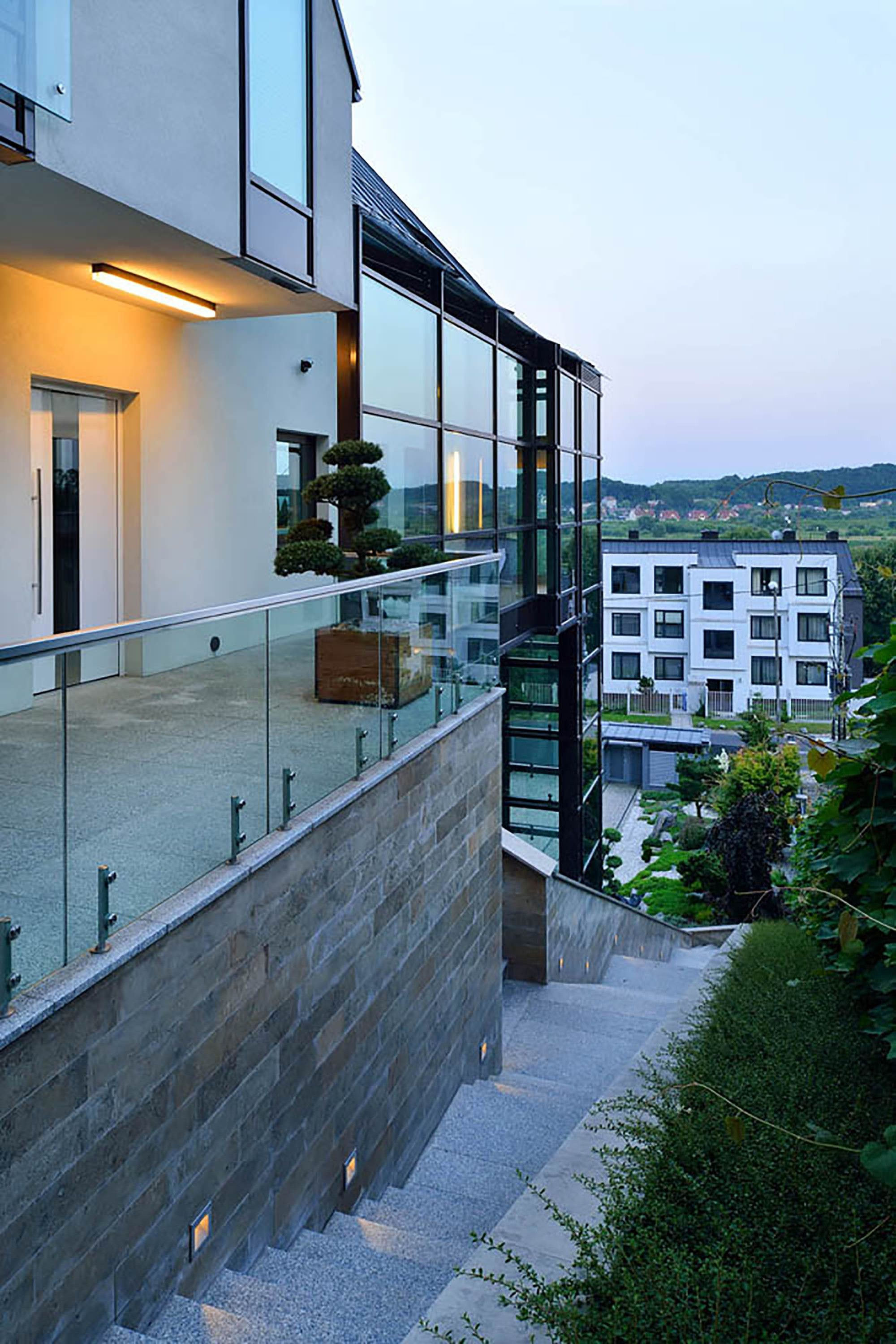 A House On A Slope Connects To Its Surroundings Through A Glass ...