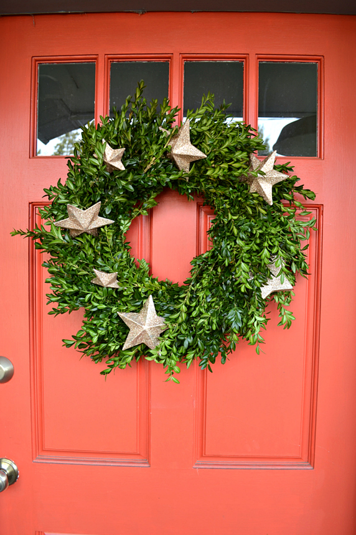 1 stars and greenery wreath - How To Decorate Your Door For Christmas