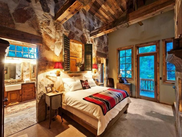 how to design a rustic bedroom that draws you in 13102 | master rustic bedroom rocks exposed