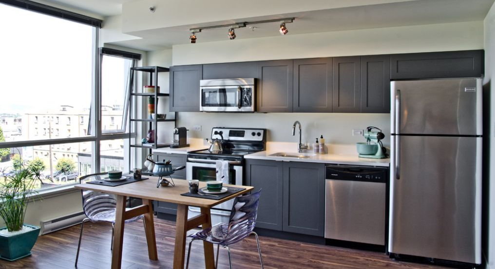 Stylish Ways To Work With Gray Kitchen Cabinets - Dark grey kitchen units