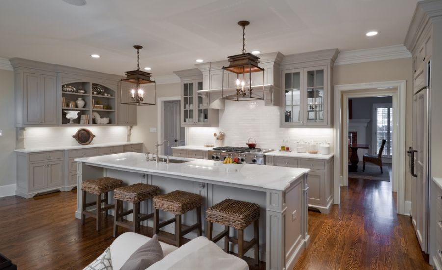 Stylish Ways To Work With Gray Kitchen Cabinets - Light grey kitchen cabinets with wood floors
