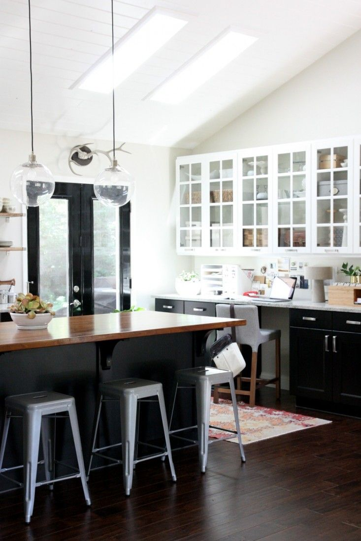 White Kitchen Vs Dark Kitchen one color fits most: black kitchen cabinets