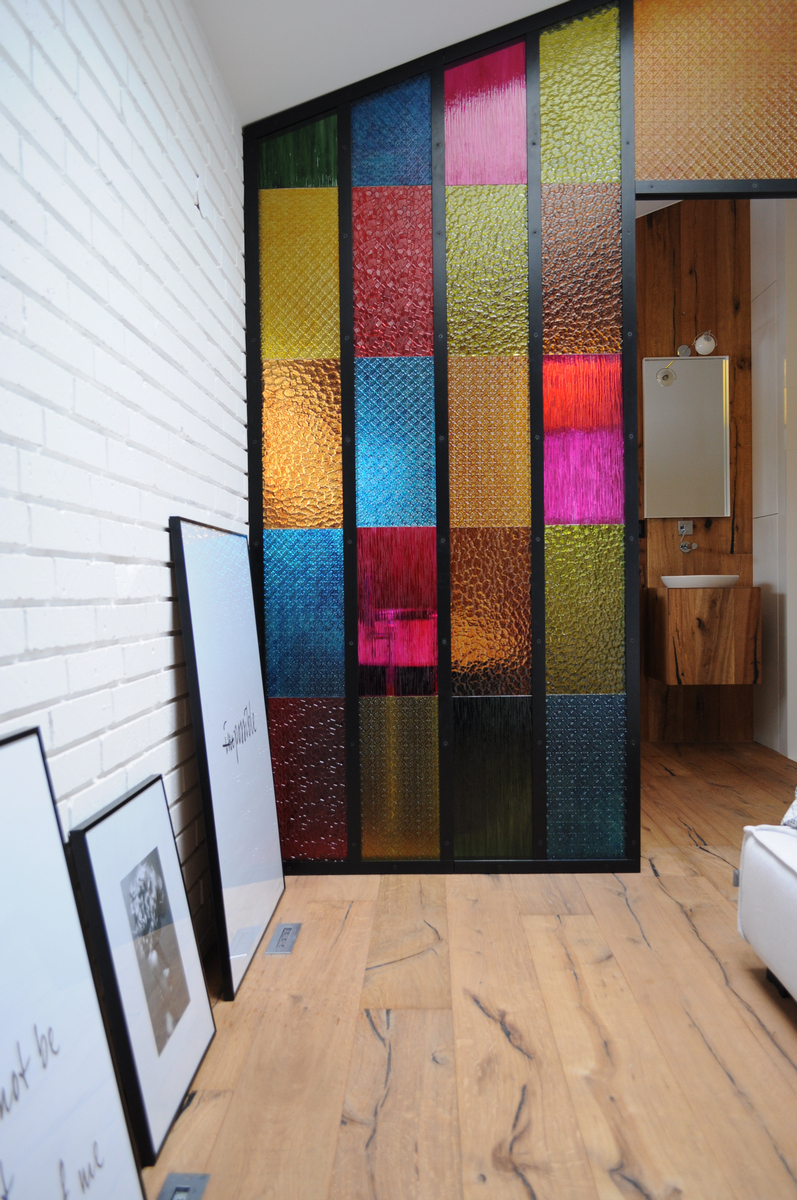 Colorful-apartment-in-Poland-bedroom-glass-divider