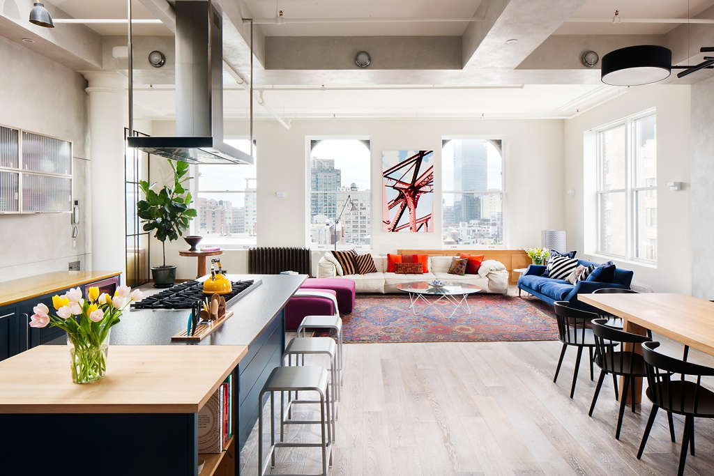Dynamic soho loft with industrial and architectural flair for Dynamic kitchen design interiors