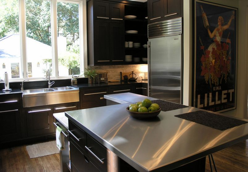 How to make the most of stainless steel backsplashes for Dark brown kitchen cabinets with stainless steel appliances