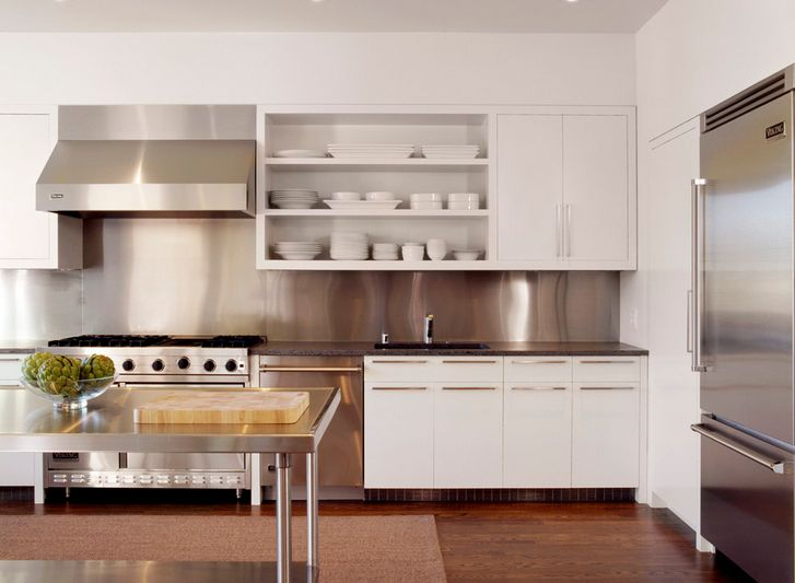 white kitchen with stainless steel backsplash