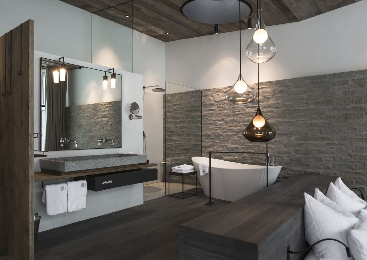 Gorgeous light fixtures. The Defining Design Elements Of Luxury Bathrooms