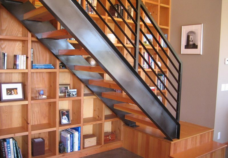 Designs that prove staircases and bookshelves make a great duo for Design interieur quebec