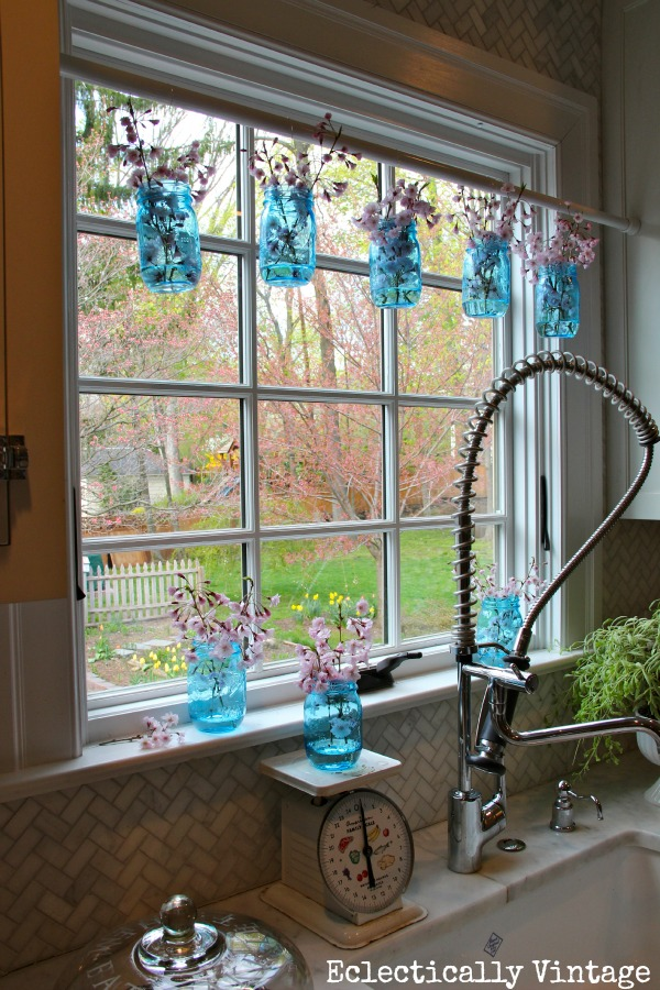 Simple ways to decorate with blue tinted mason jars for Mason jar kitchen ideas