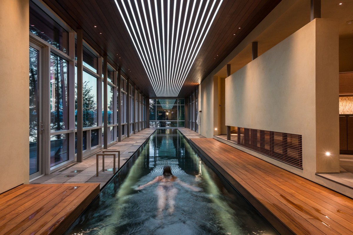 The benefits of lap pools and their distinctive designs for Inground indoor pool designs