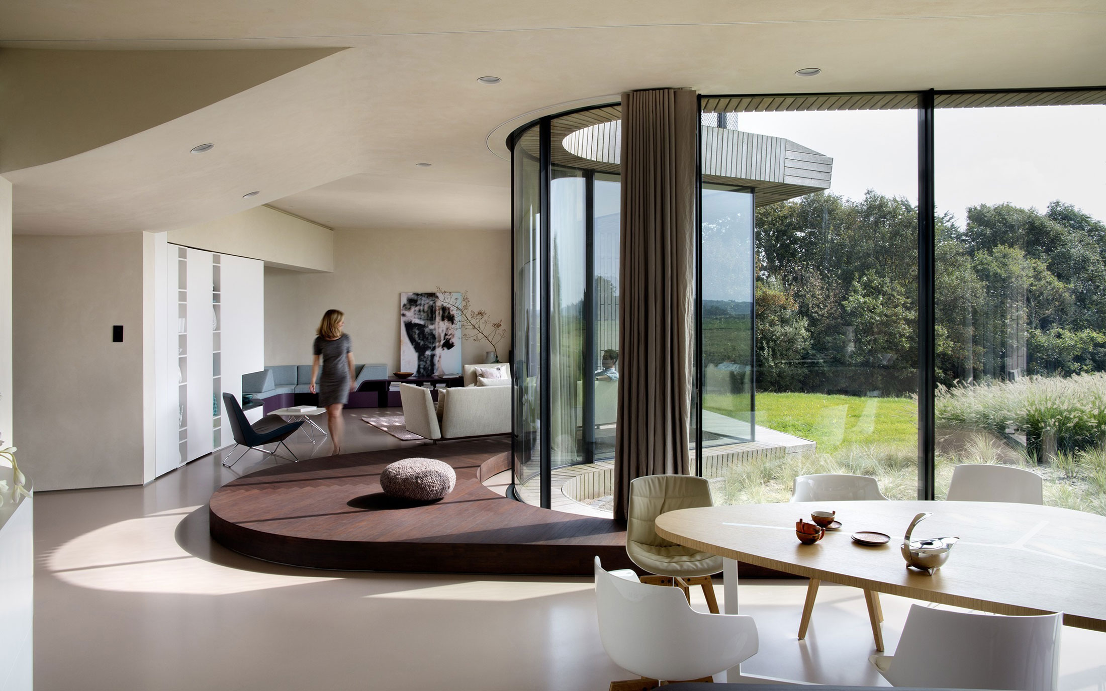 smart residence features a flower shaped floor plan the w i n d house dining table and curved facade