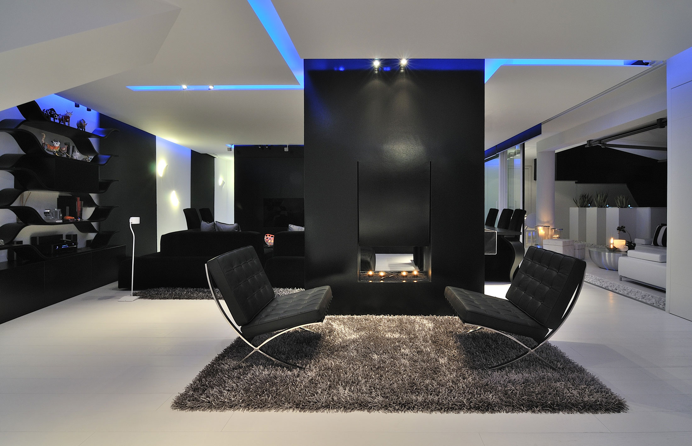 blue lit residence with black and white flair. Black Bedroom Furniture Sets. Home Design Ideas
