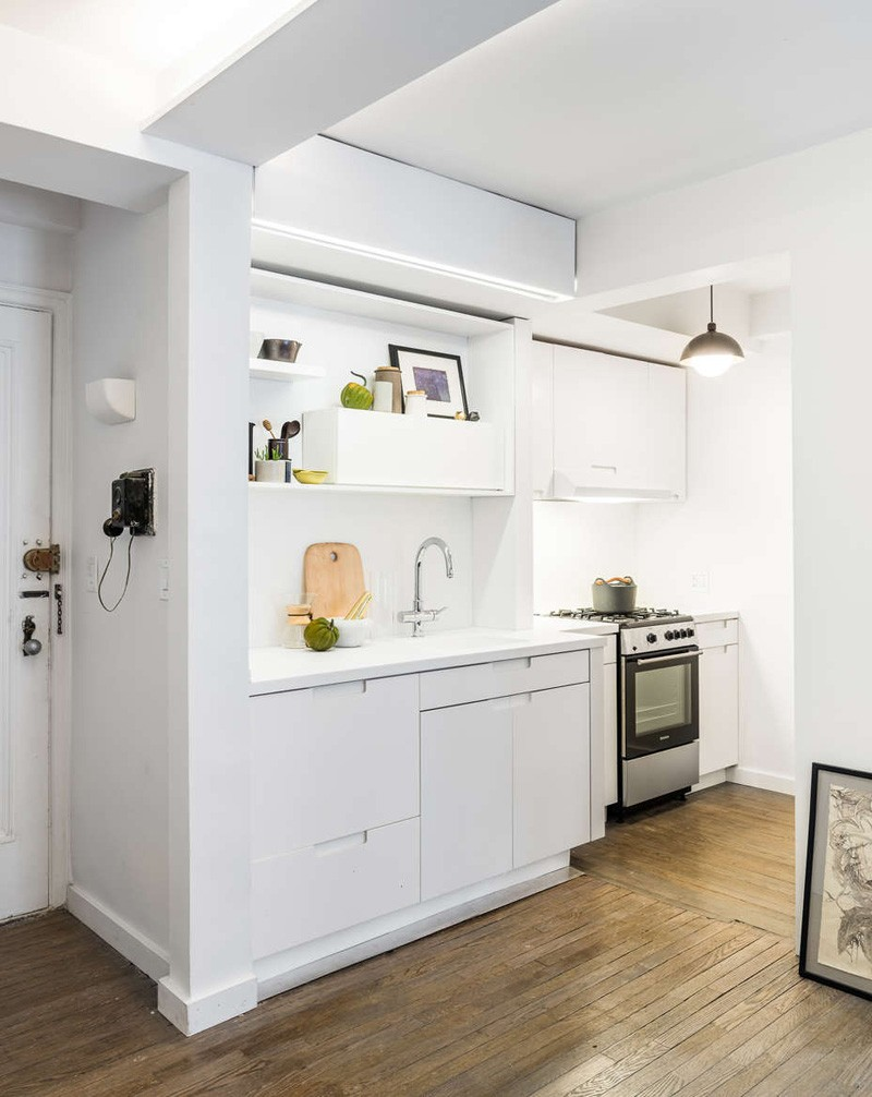 Small Apartment Utilizes A Sliding Wall To Hide Its Functions : micro apartment kitchen from www.homedit.com size 800 x 1006 jpeg 124kB