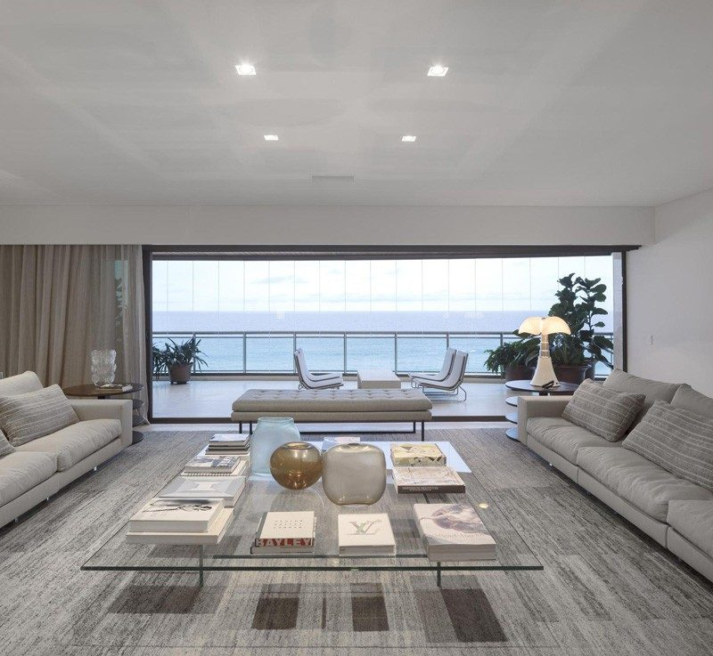 Luxury Apartment Invites The Ocean Into Its Art-Infused Rooms