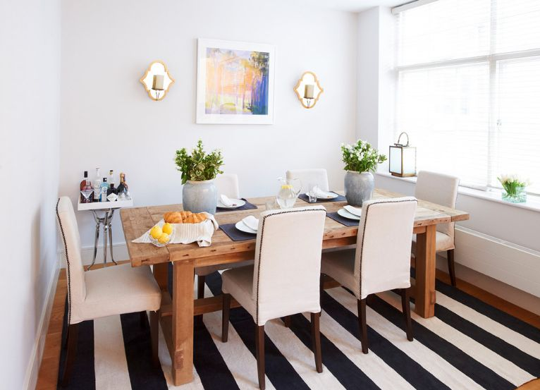 How To Enhance A Decor With Black And White Striped Rug