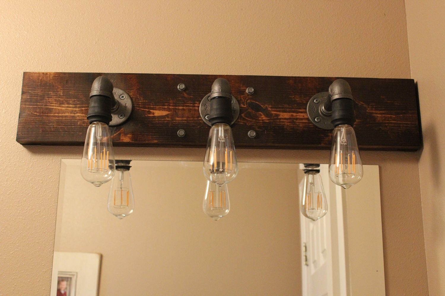 Diy industrial bathroom light fixtures for Over mirror bathroom lights