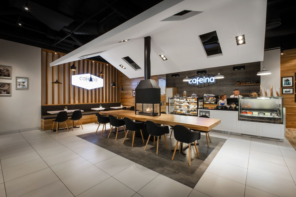 The new cafeina caf makes its guests feel right at home for Interior house designs black and white