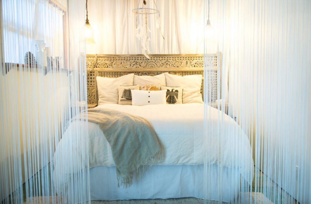 antique-door-headboard - Clever Repurposing - Door Headboard Ideas