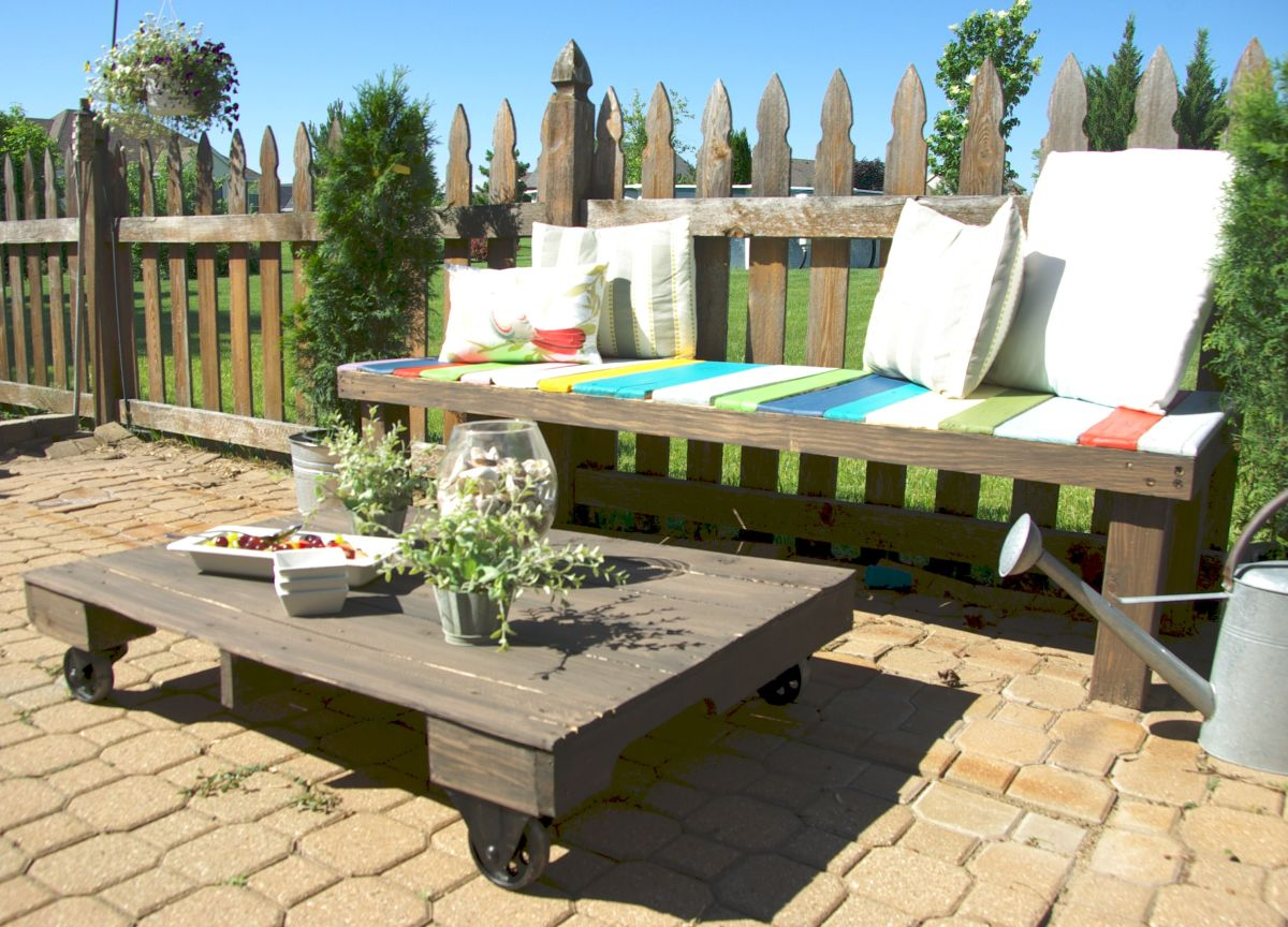 Maximize your outdoor space with a pallet coffee table on for Garden rooms on wheels
