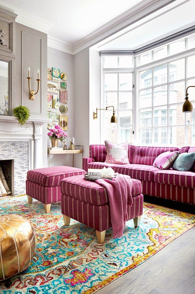 pink-sofa-and-ottomans-on-colorful-rug