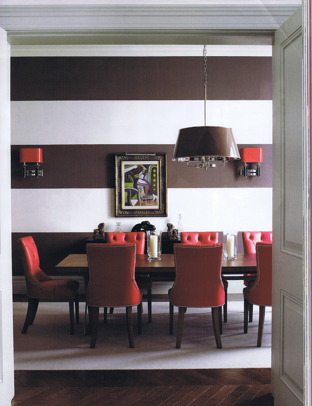 Red brown dining room with pops of red