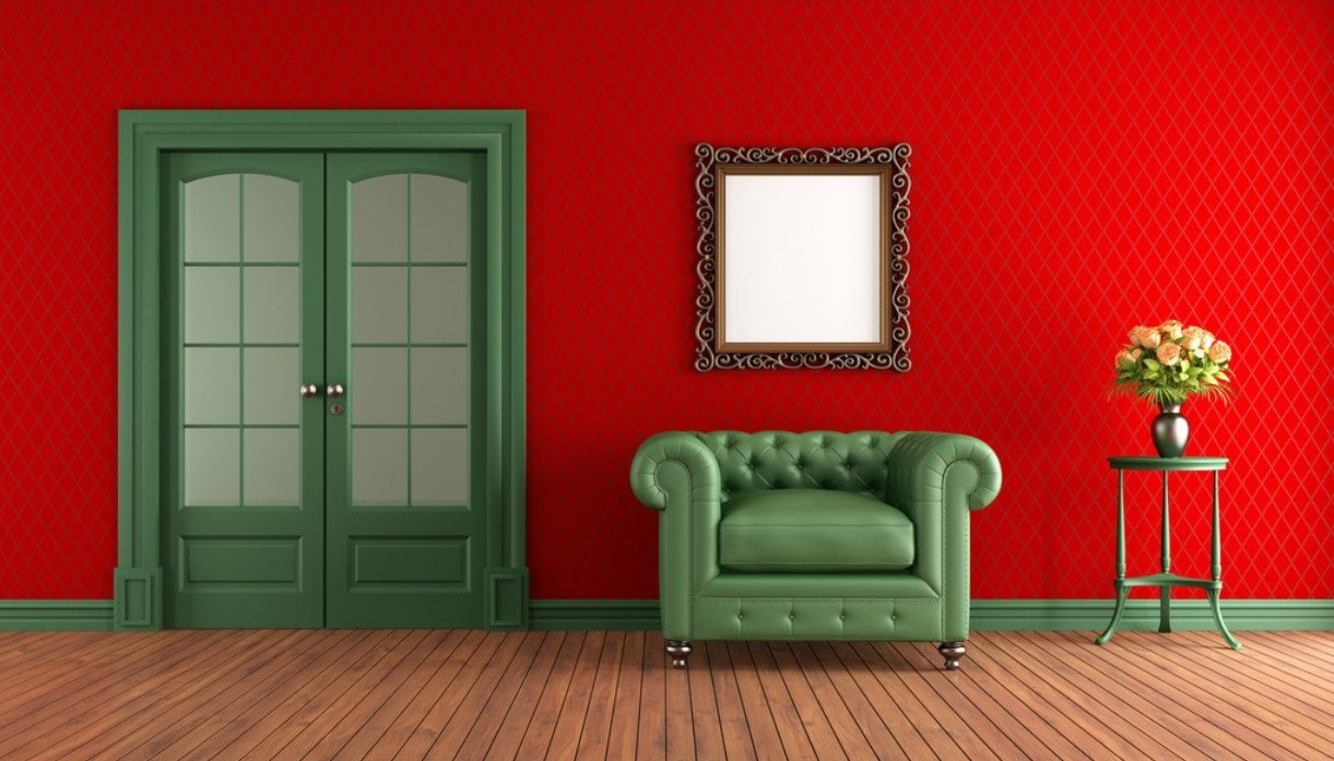 red-walls-green-armchair-in-living-room