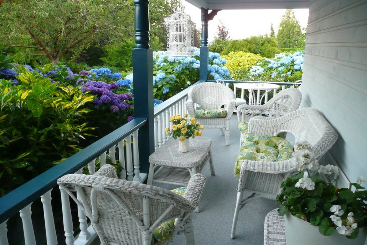 White Wicker Patio Furniture Intended Smallwhiteporchwithwickerchairs Summer Decors Infused With White Wicker Furniture