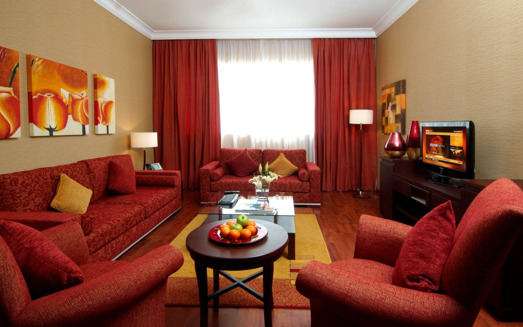 red wall living room.  20 Colors That Jive Well With Red Rooms