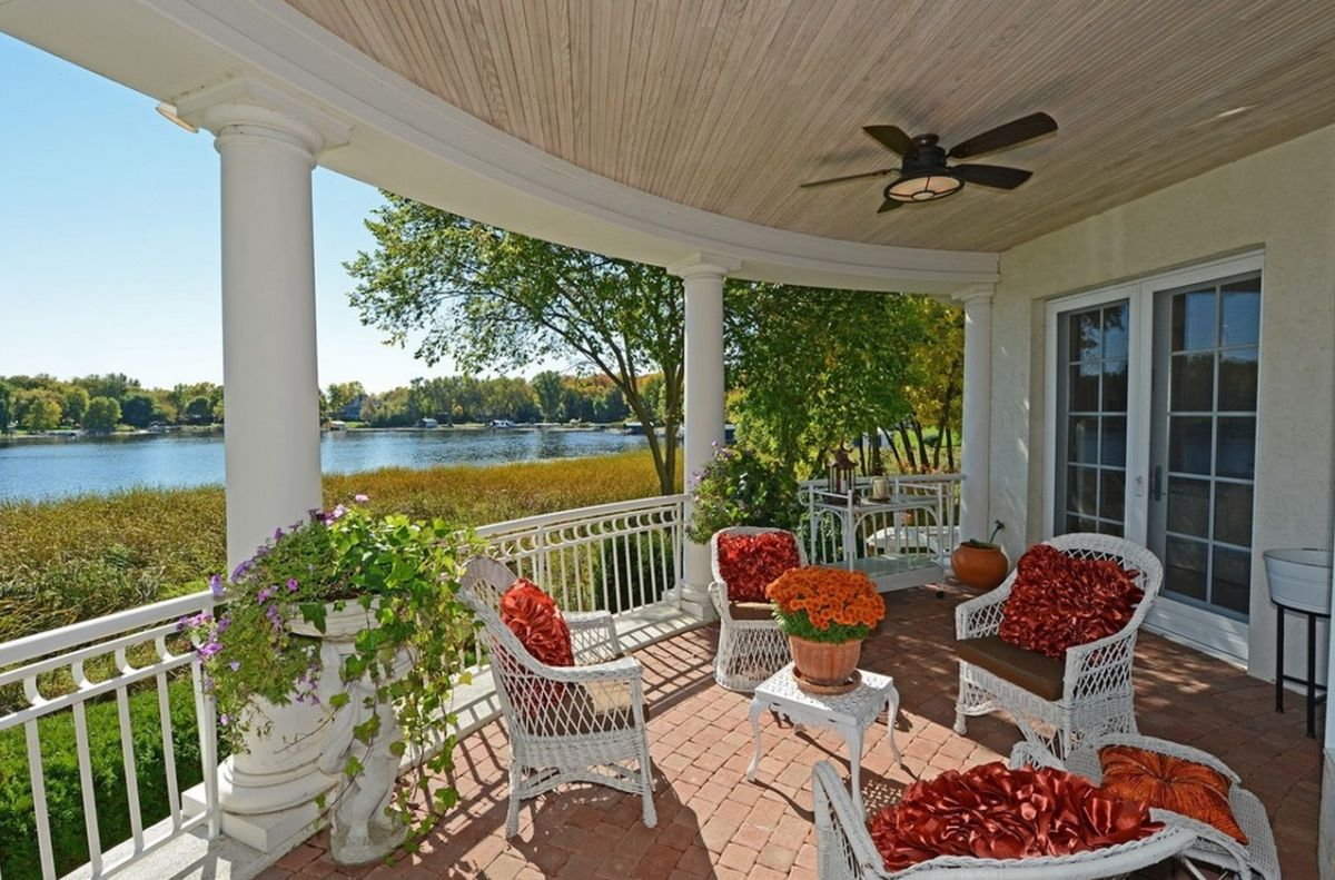 traditional-porch-with-white-and-red-accents