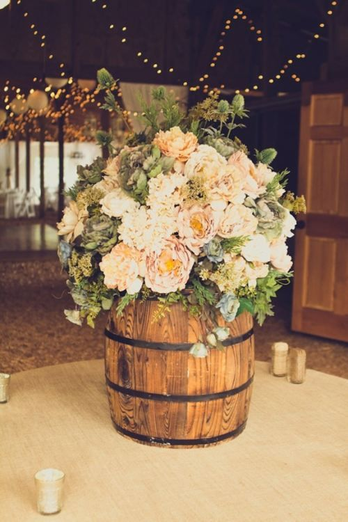 Say i do to these fab 51 rustic wedding decorations wine barrel floral arrangement junglespirit Choice Image