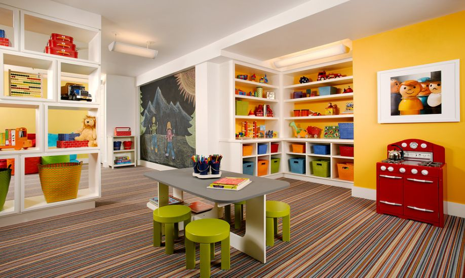 Colorful plaryroom with tons for storage spaces