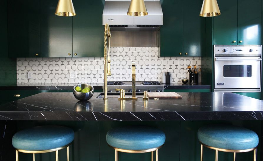 Gold accents on a black featured kitchen
