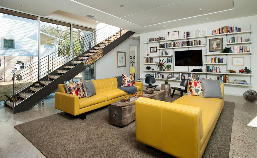 Interior design of a loft featuring two yellow couches