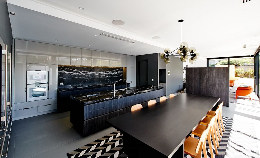 Matching the backsplash and kitchen island counter top with black marble