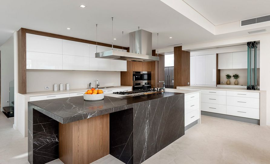 Modern open space kitchen featuring black marble and wood