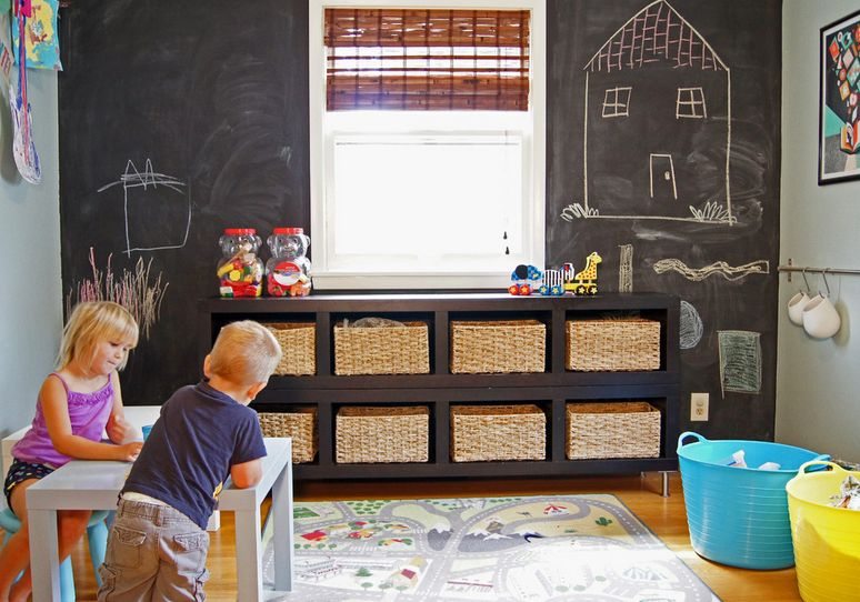 Playroom with chaclboard wall and rattan baskets