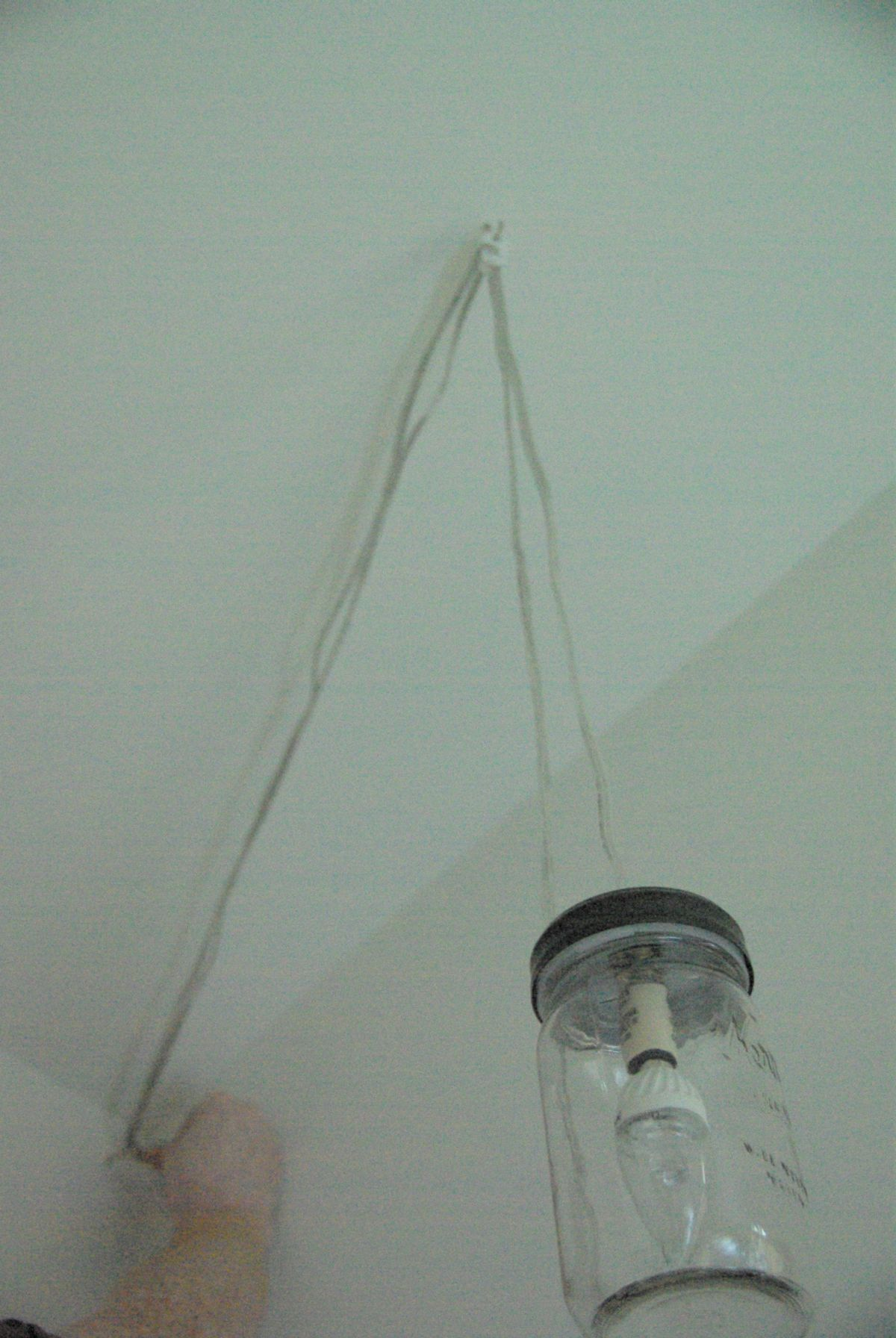 Pulling ceiling light cord tight