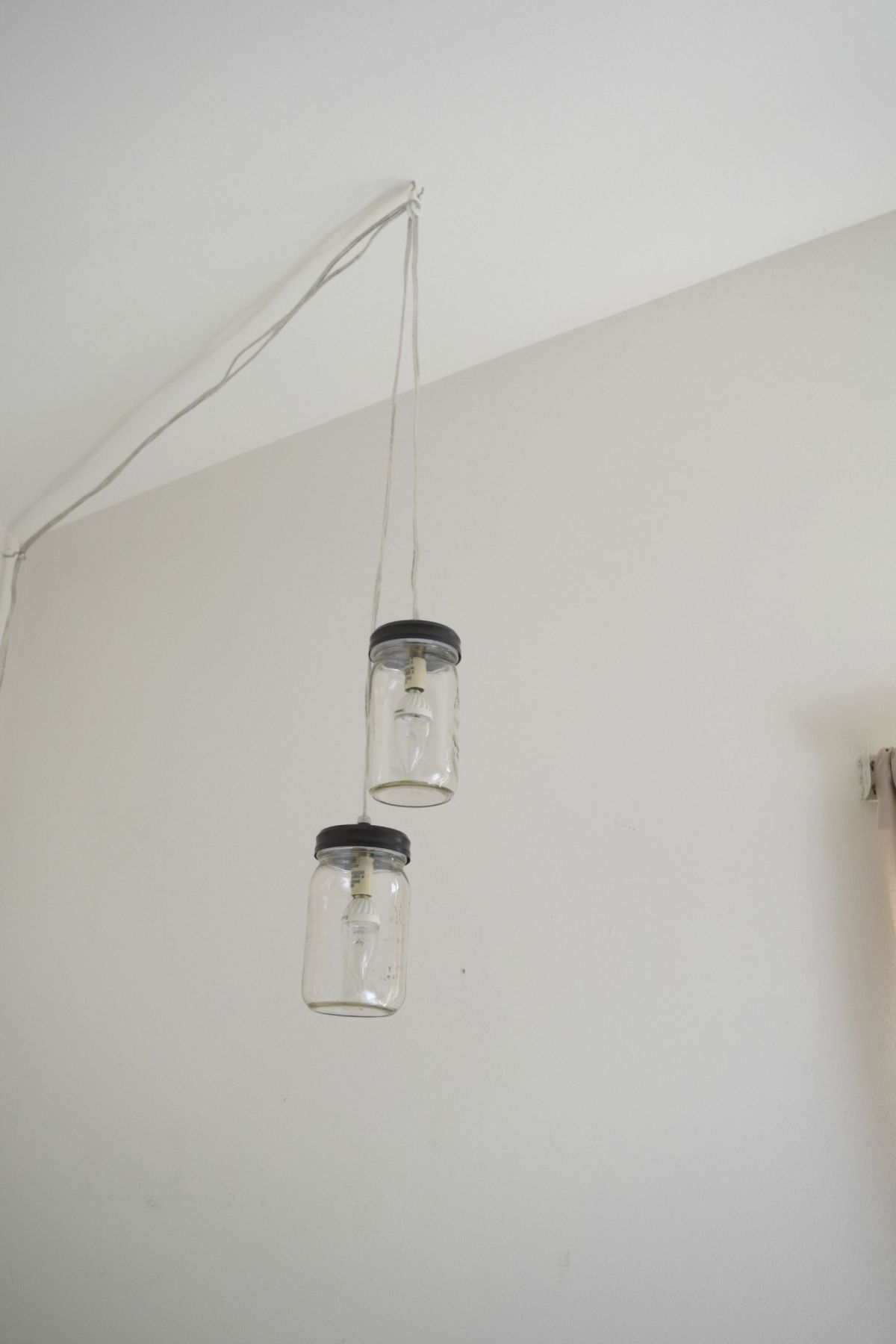 Recycle mason jars and turn them into lighting fixtures